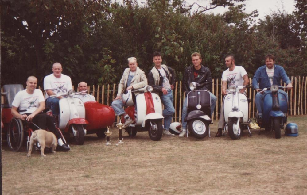 Midhurst Detours members sitting on their scooters