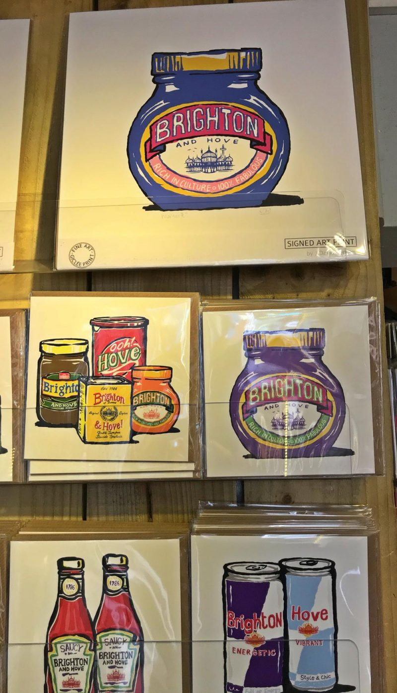 Marmite jars, ketchup bottles and red bull cans with Brighton and Hove text on them,
