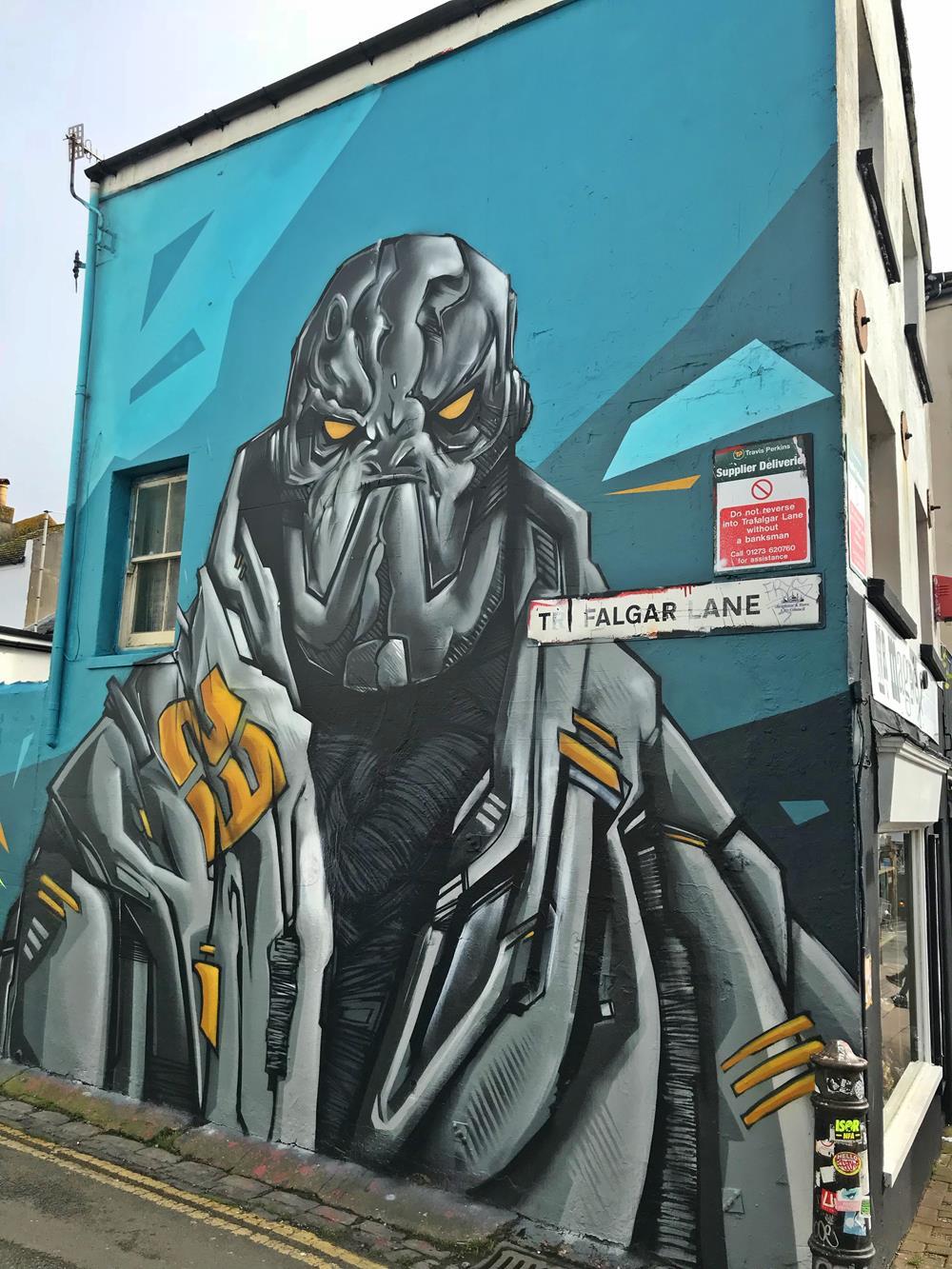 A wall mural by Snub in Trafalgar Lane, Brighton