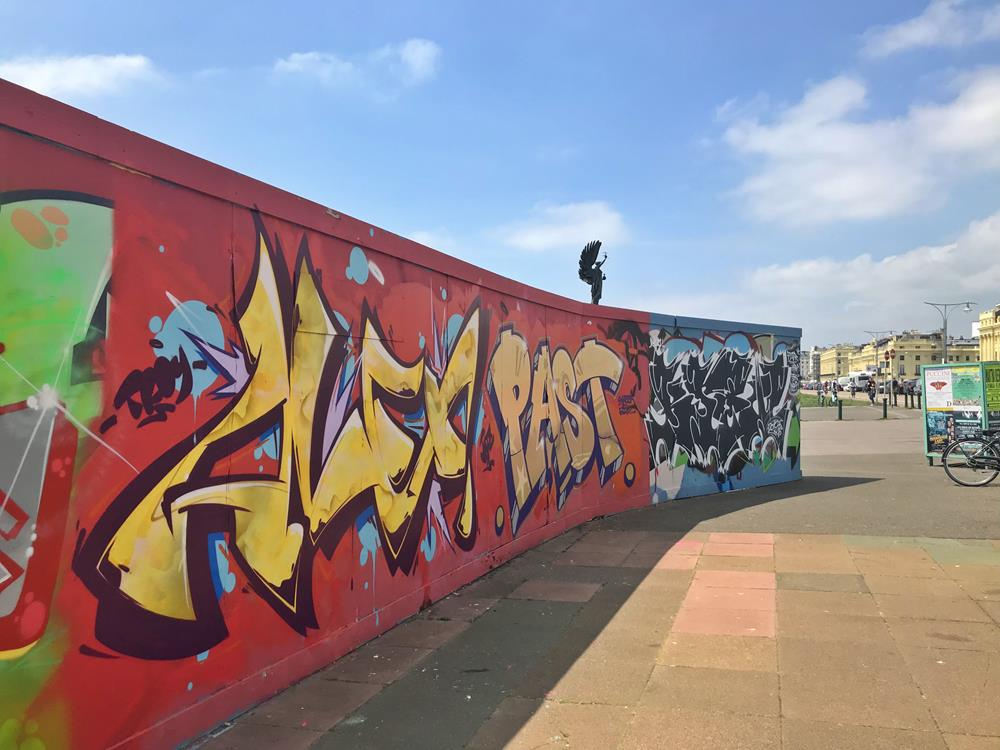 Brightly-painted hoardings near the Peace Statue in Hove