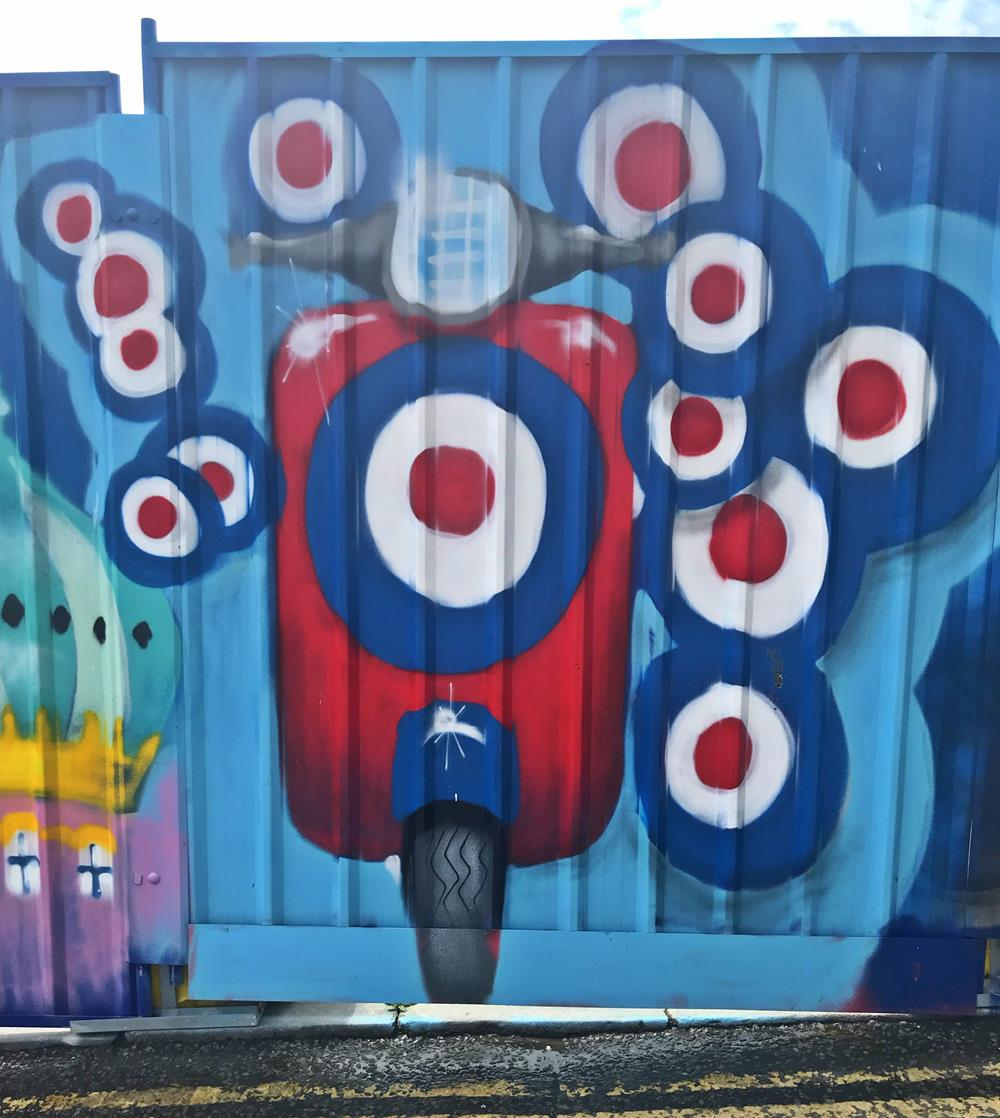 A mod-style Vespa scooter surrounded by targets, by Glimmertwin 32
