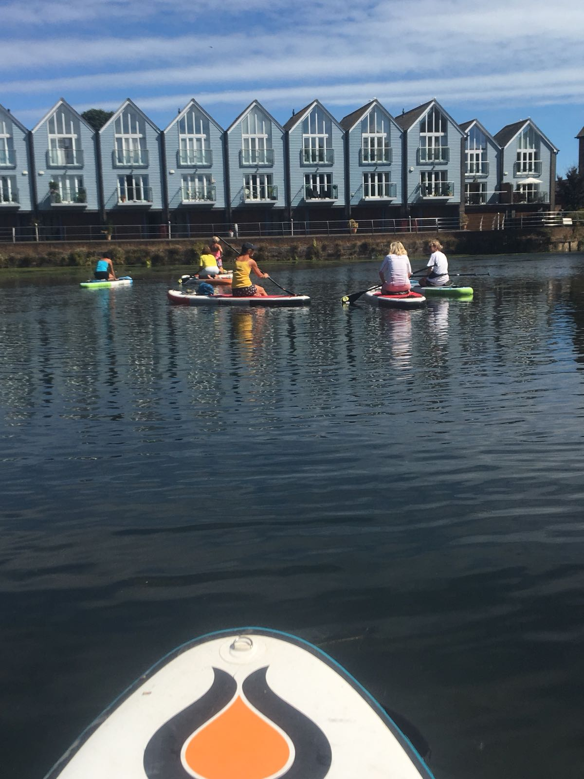 Paddle boarders in Chichester basin