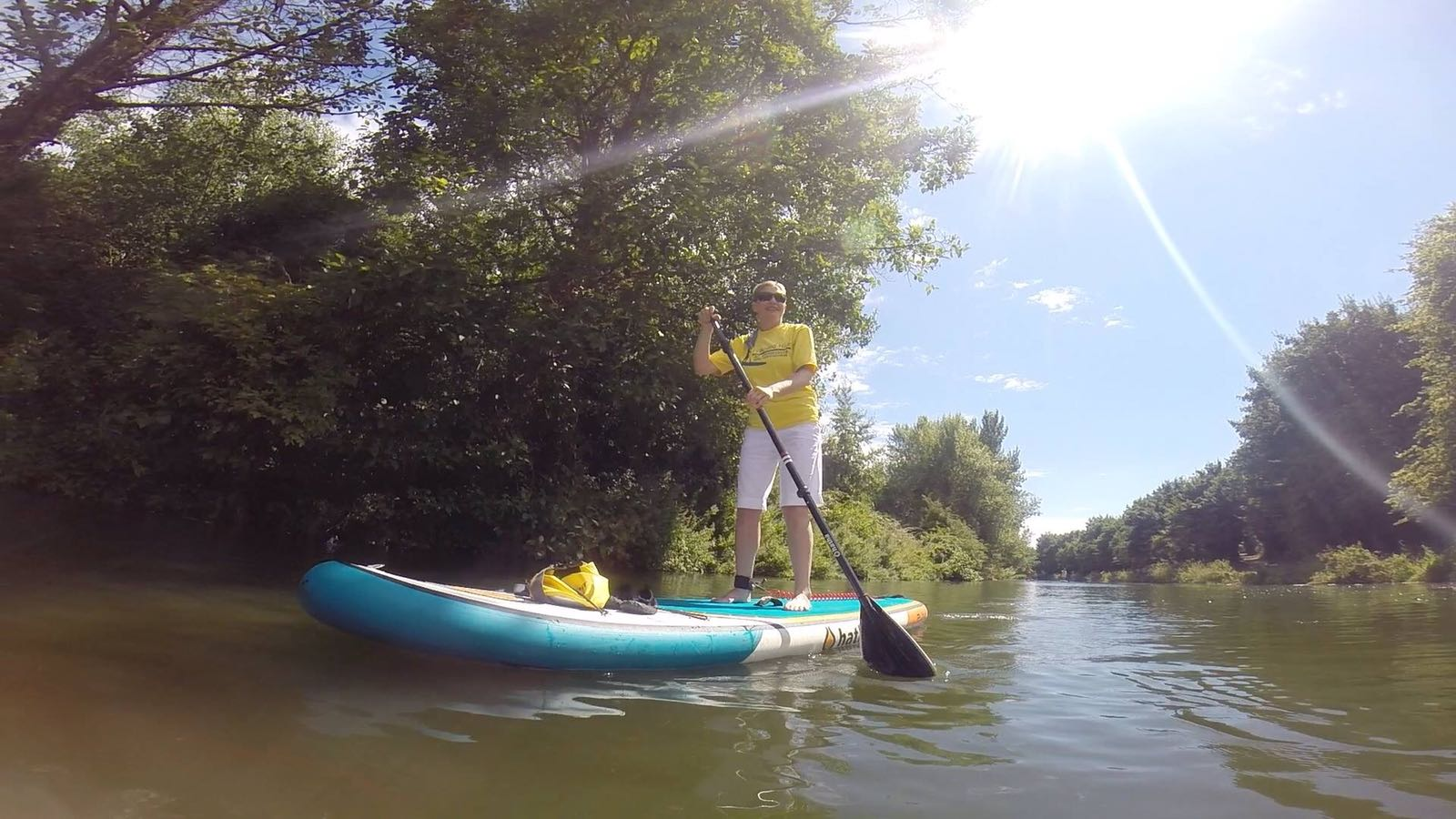 Paddle boarding along Chichester Canal in West Sussex