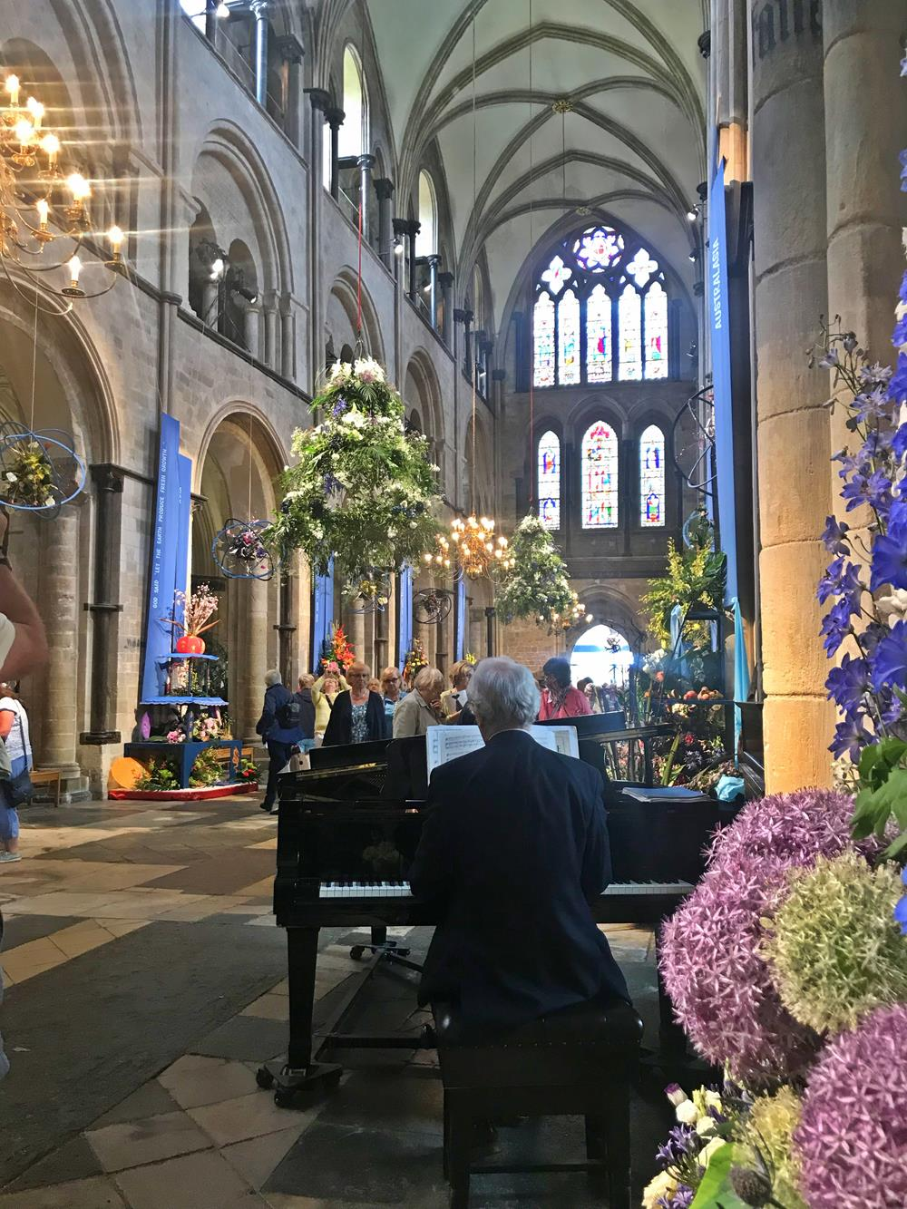 Pianist at a grand piano in Chichester Cathedral