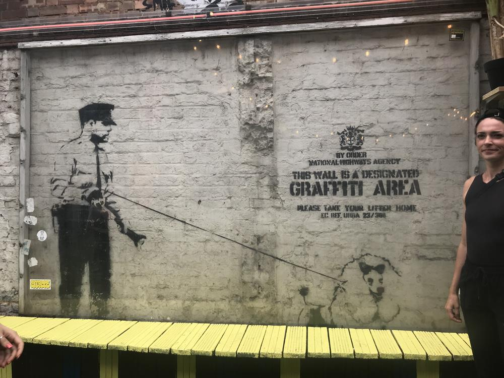 Banksy art in Shoreditch, of a policeman with a poodle on a lead