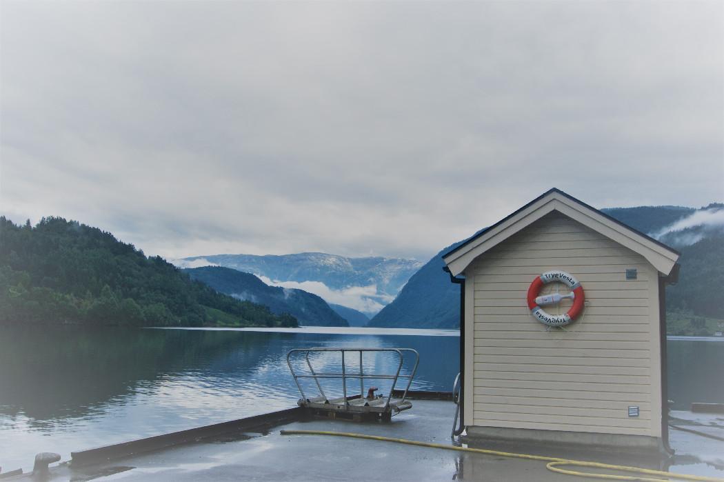 Small hut overlooking the still fjord