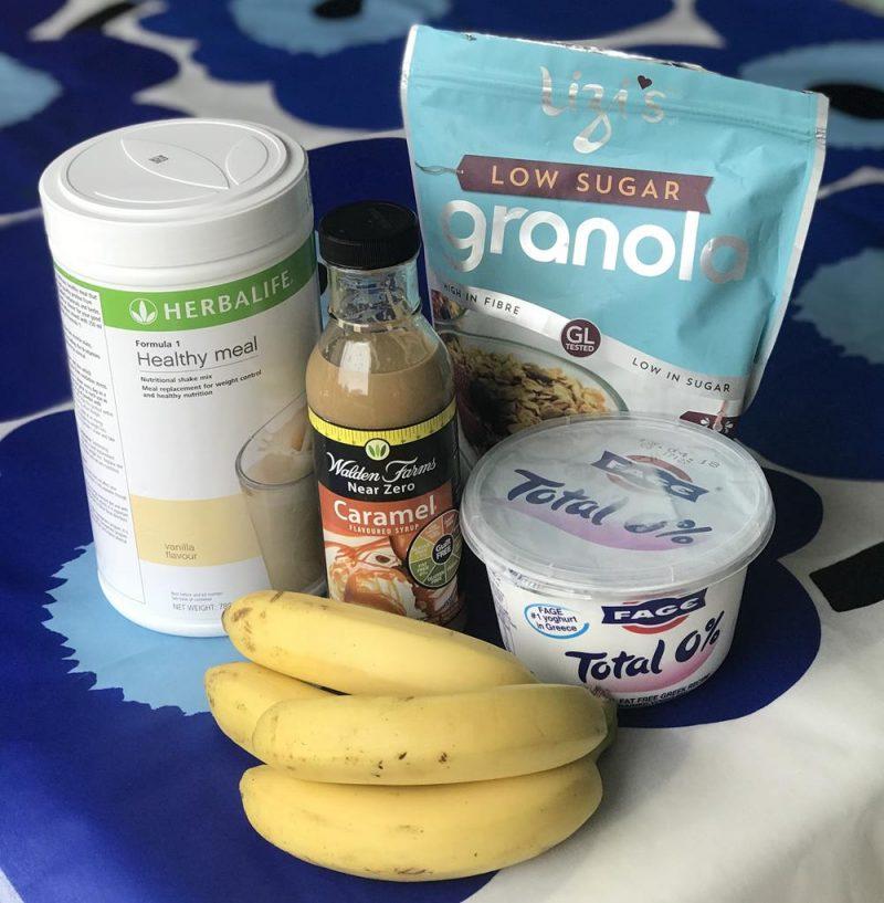 Herbalife F1 powder, bananas, fage total 0% yogurt, walden farms caramel sauce and Lizi's low sugar granola