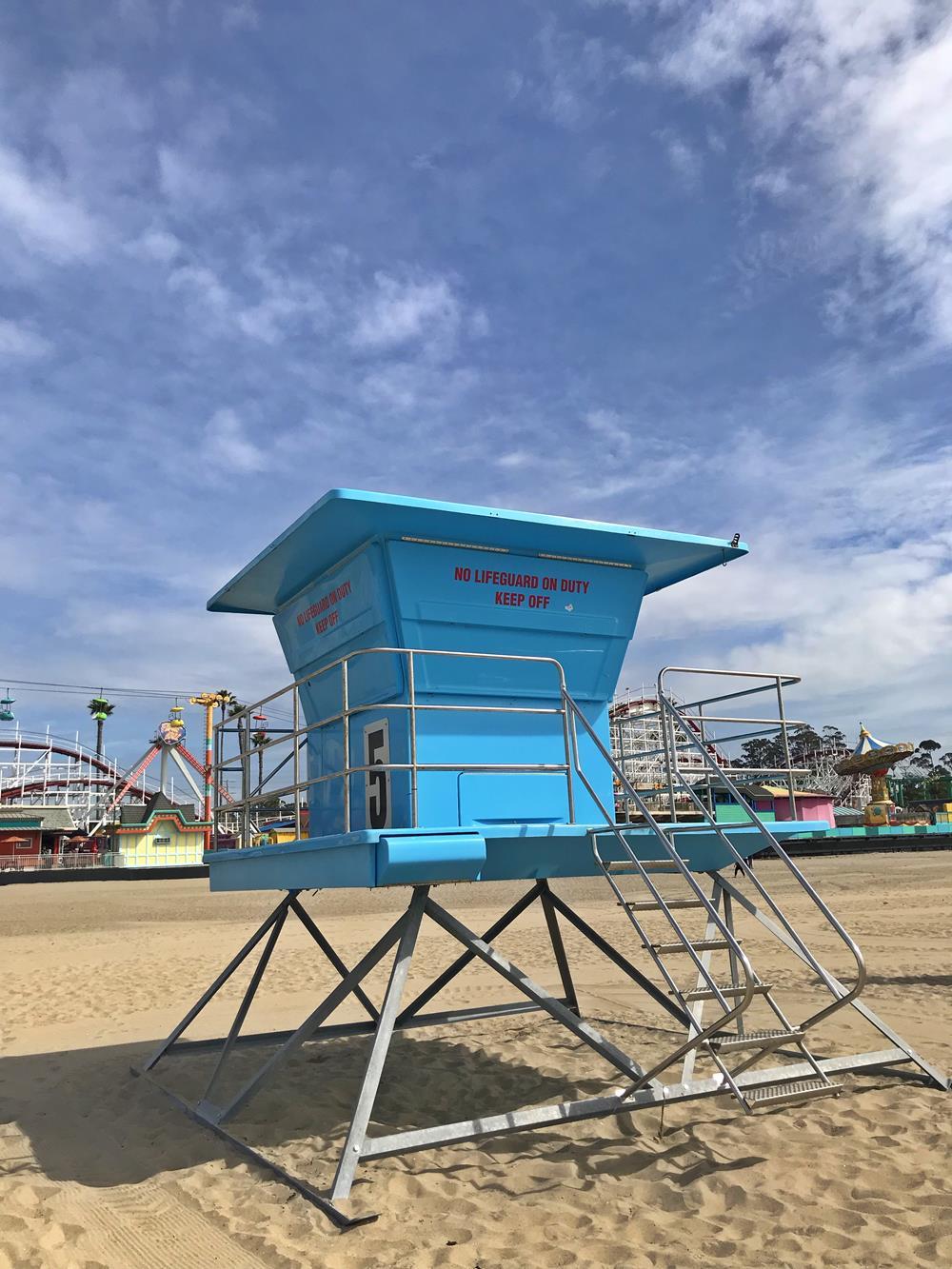 A bright blue lifeguard shelter on Santa Cruz beach