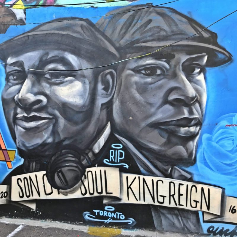 Two black men with flat caps and the text Son Of Soul and King Reign