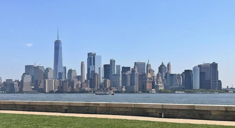 View of New York skyline on a sunny day with blue skies from Ellis Island