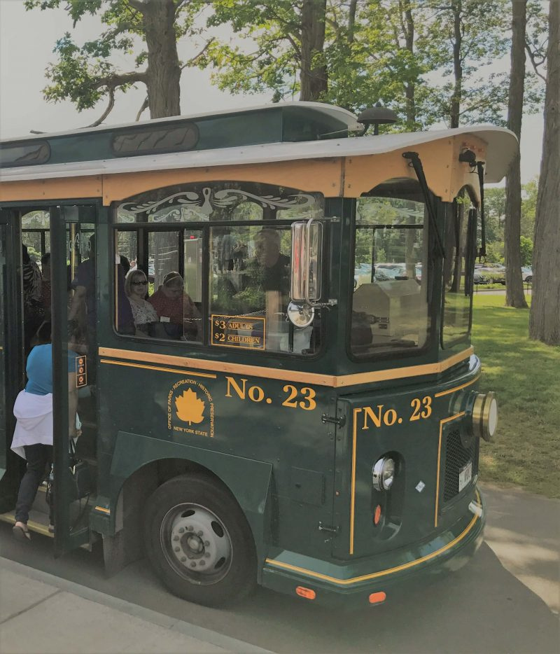 Old fashioned green tram bus