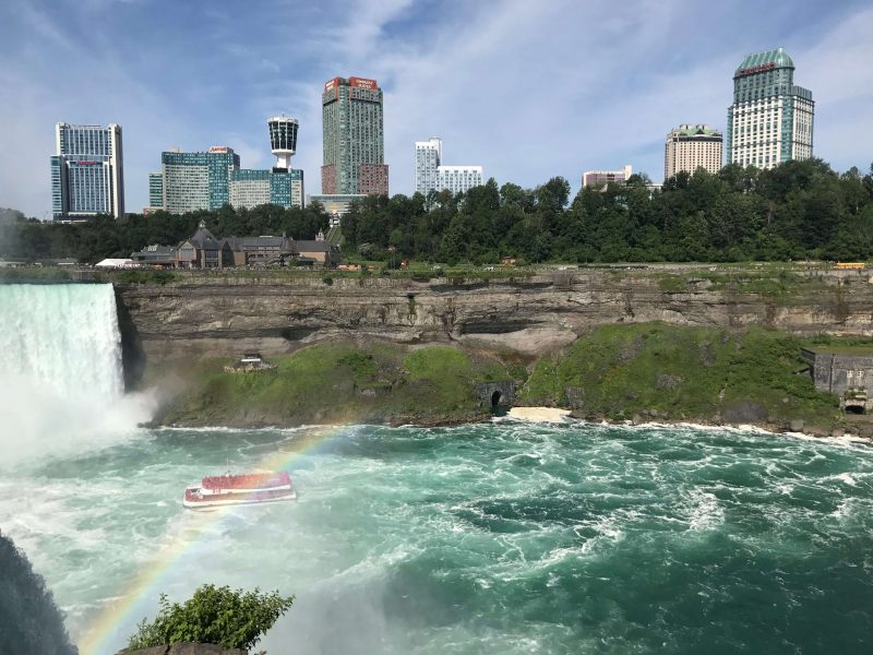View over to the Canadian side of the Falls with hotels in the background and the Hornblower boat in the river