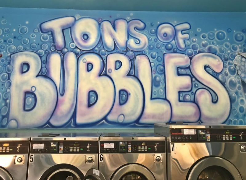 Mural on the wall of a San Francisco laundrette which says Tons Of Bubbles