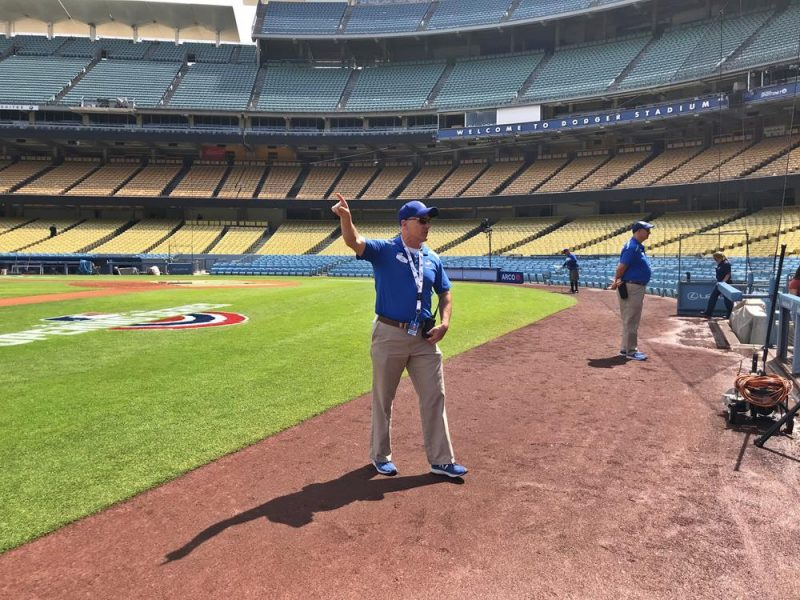 Our tour guide on the track at the Dodgers Stadium