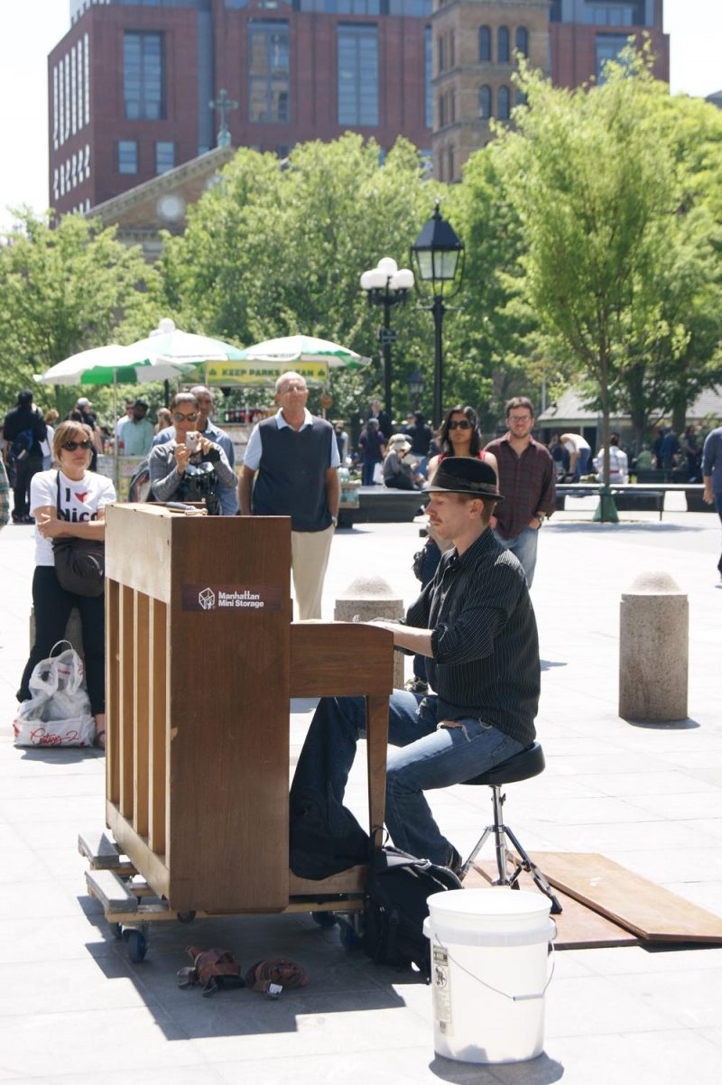 Street performer playing the piano in Washington Square Park