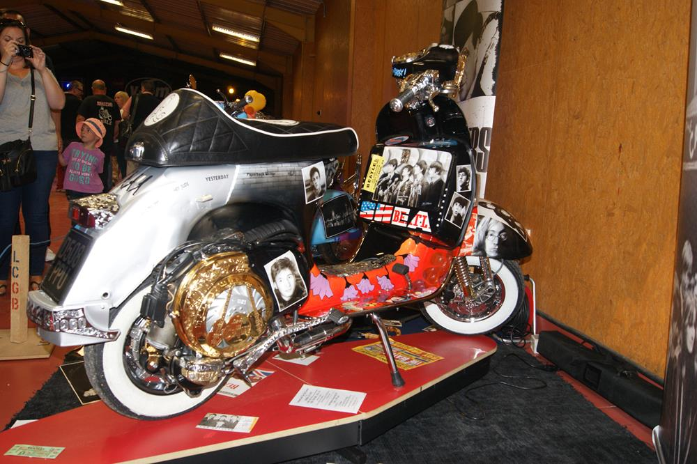 Custom Vespa with gold plated engine and Beatles theme