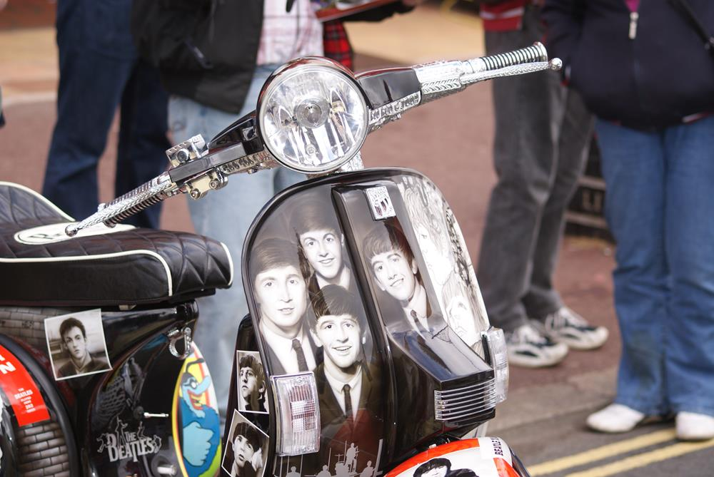 Beatles image on the front fairing of this custom Vespa