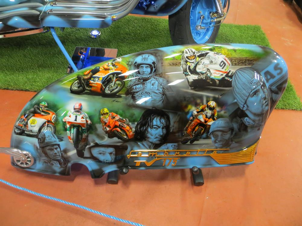 Side panel showing racing-themed murals on a Lambretta