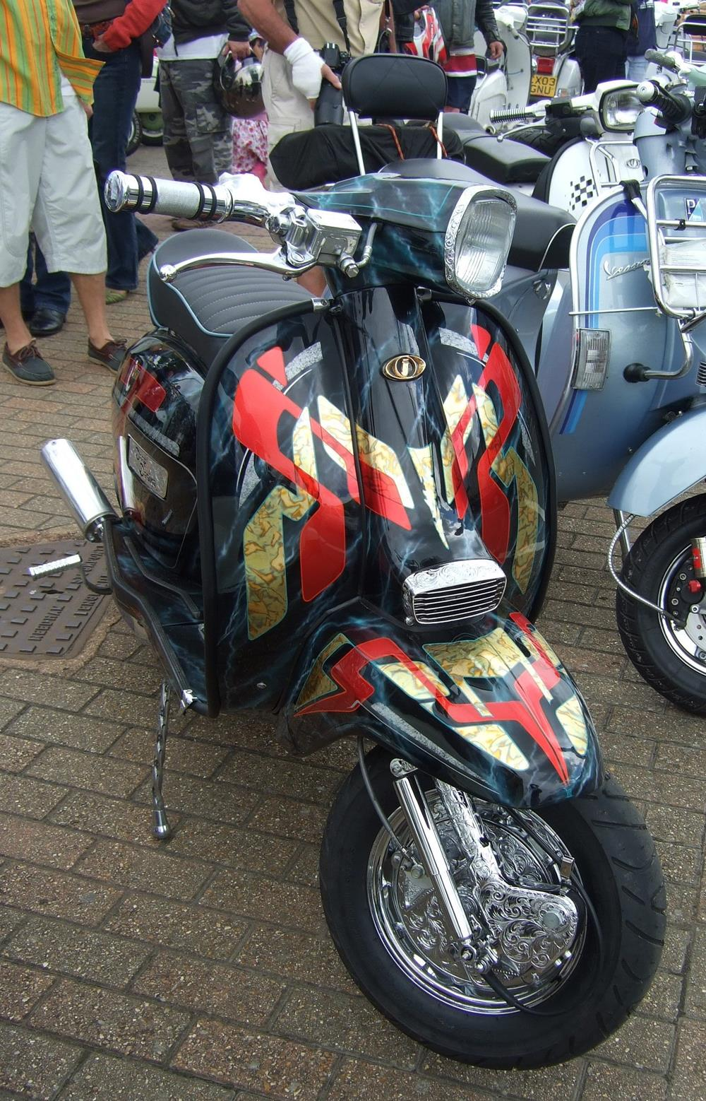 Lambretta with red and gold murals