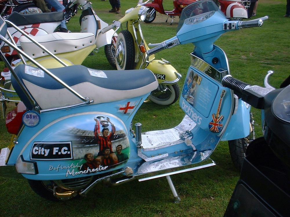 Oasis and Man City themed scooter