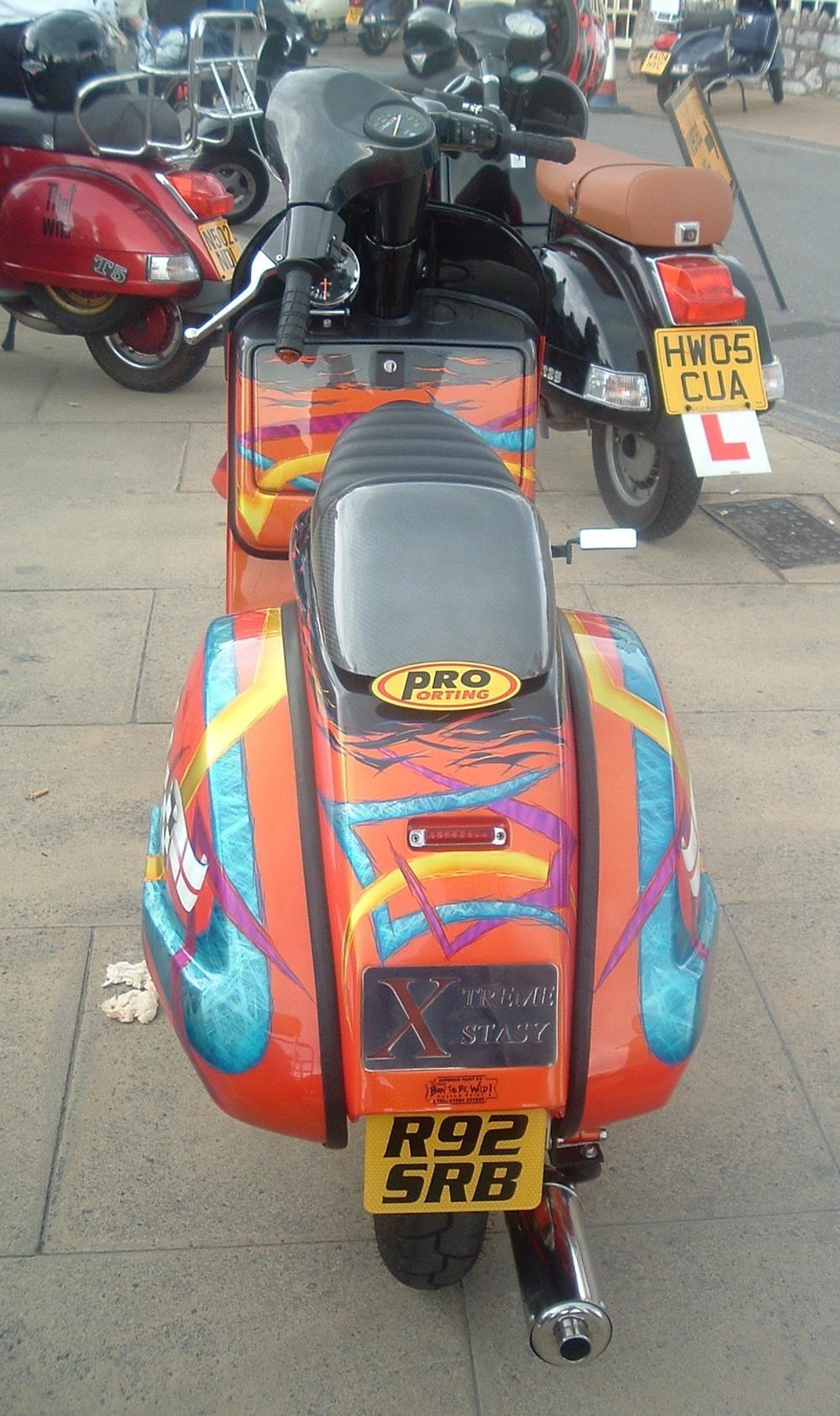 Orange Vespa PX scooter