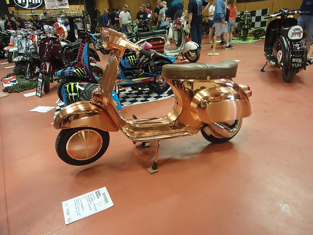 Vespa Primavera with a copper finish
