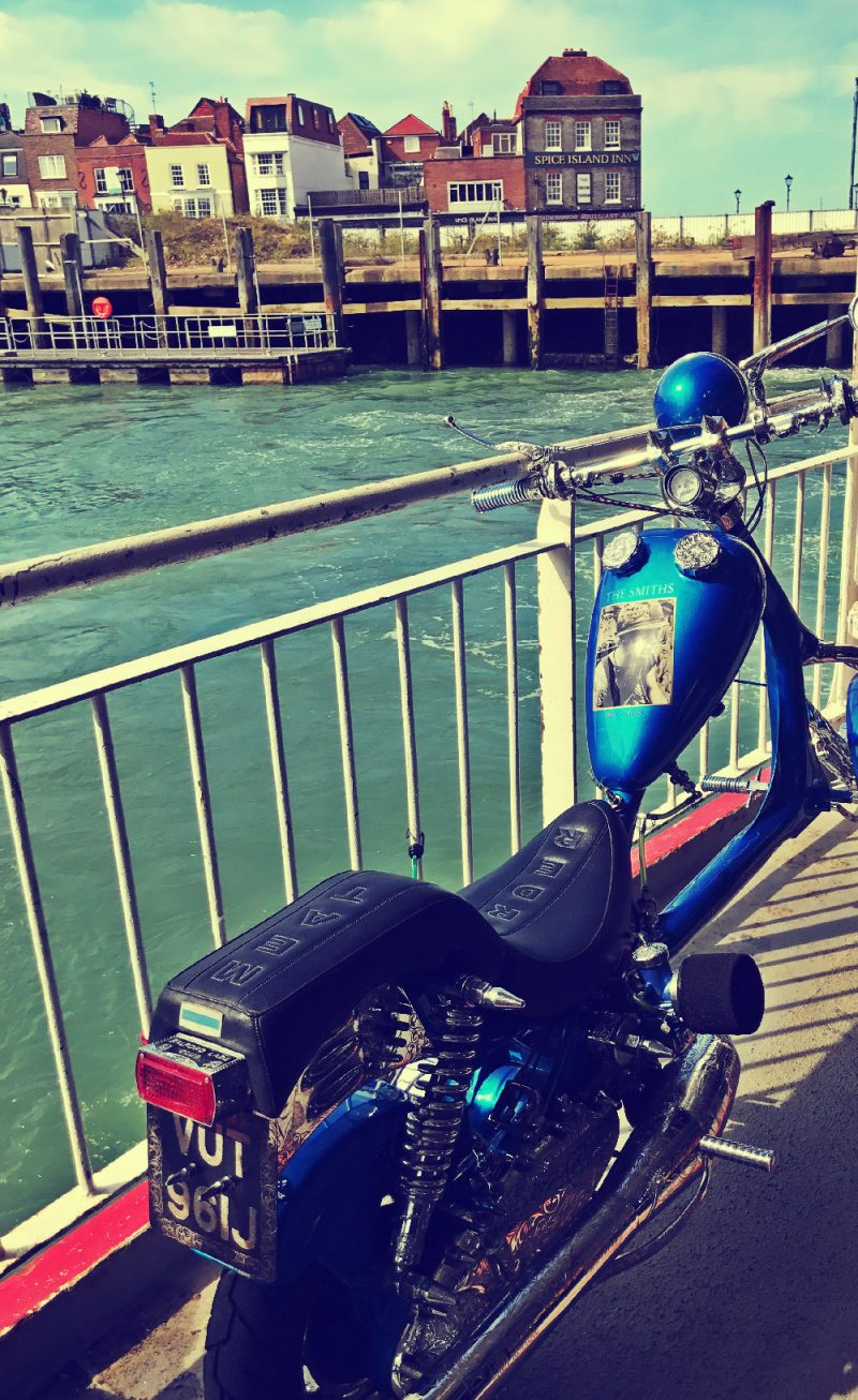 A Lambretta chopper on the ferry with Spice Island pub in Southsea in the background