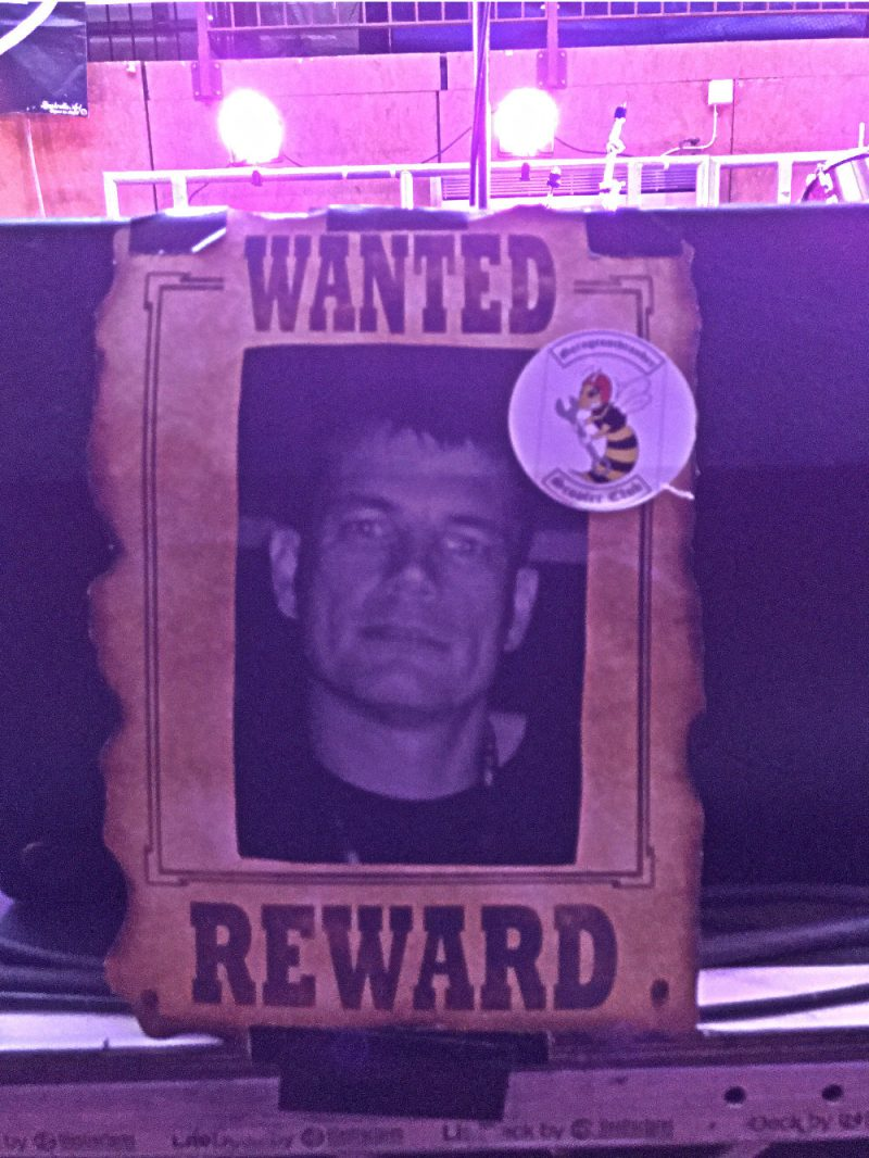 A western-style Wanted poster with a photo of Steve Foster on it
