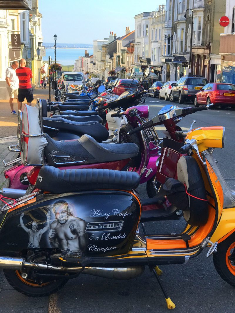 View of Lambrettas and Vespas down Union Street in Ryde