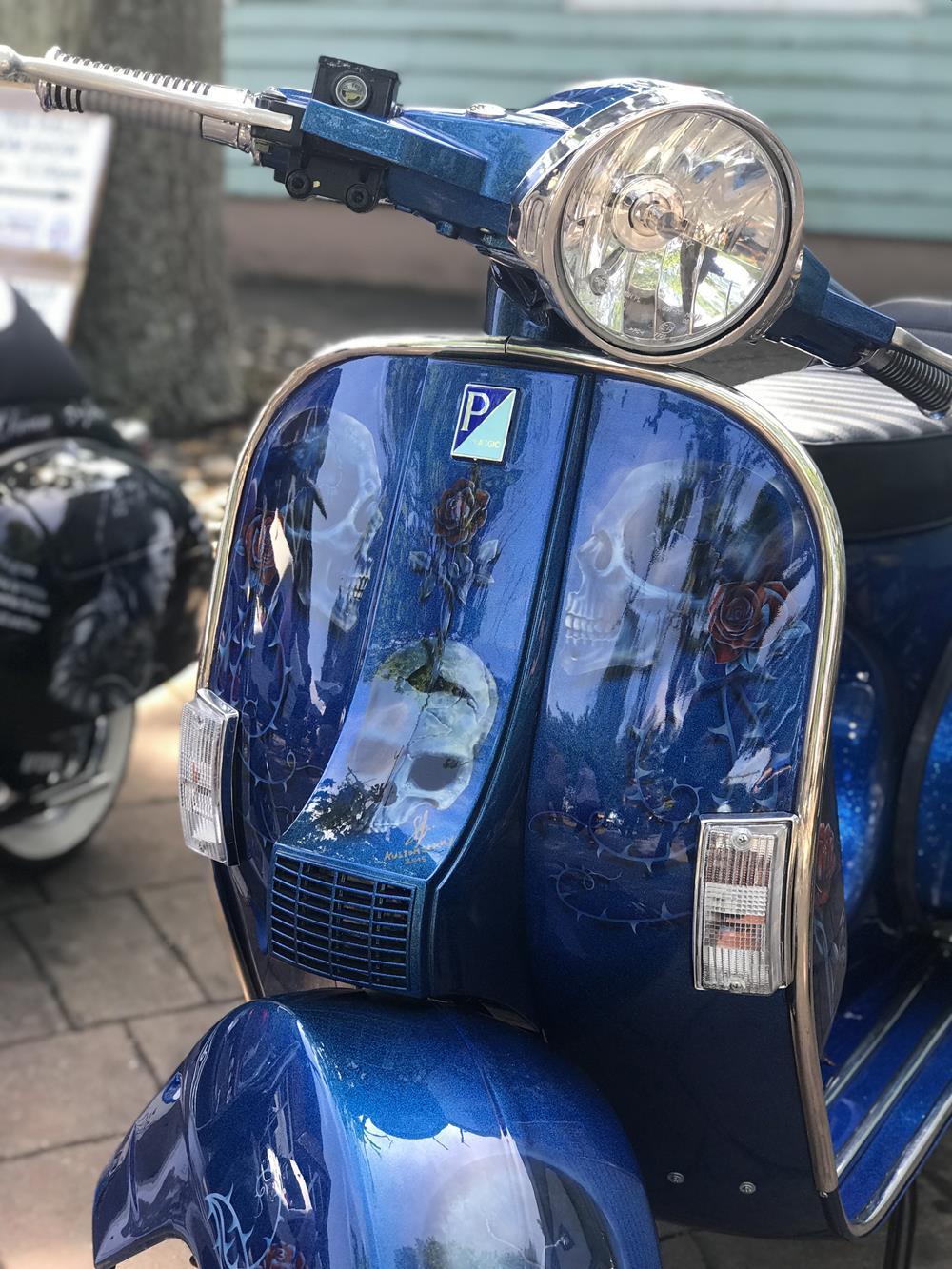 Blue custom Vespa with skull murals