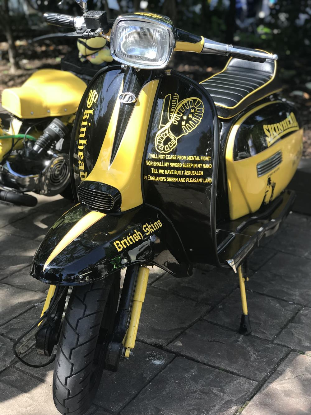 Yellow and black skinhead scooter