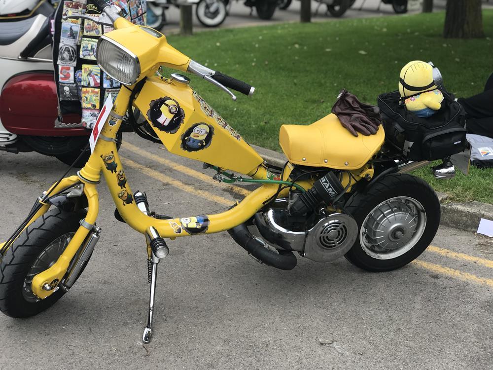 Yellow Lambretta cutdown scooter with Minion murals