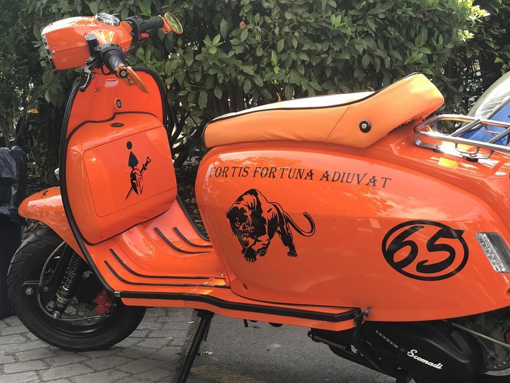 Orange Scomadi scooter