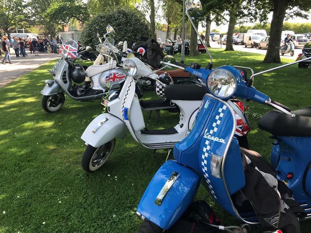 Blue PX Vespa scooter