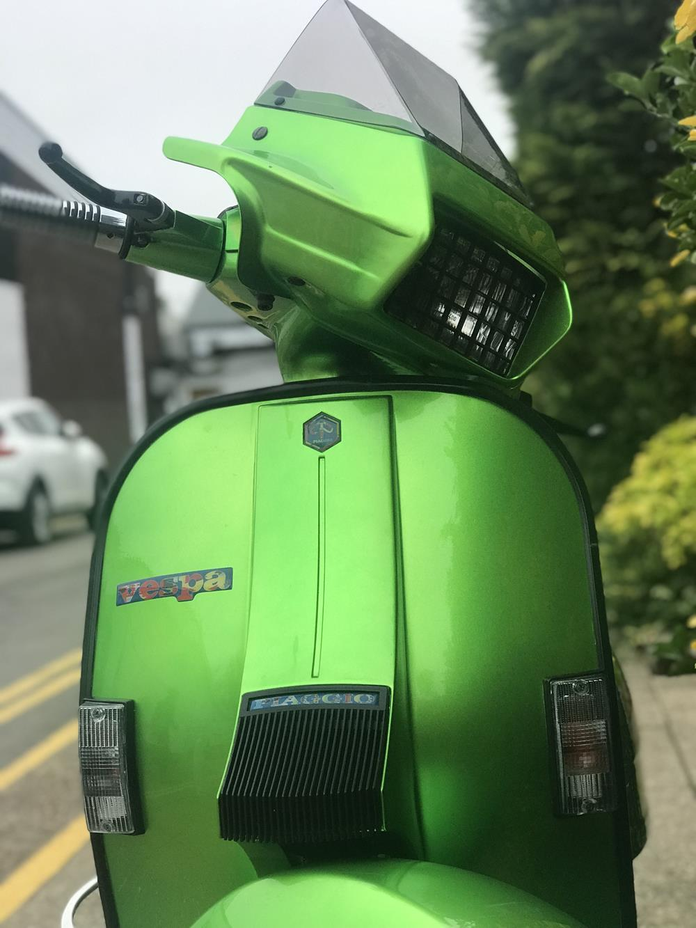Green Vespa PX scooter
