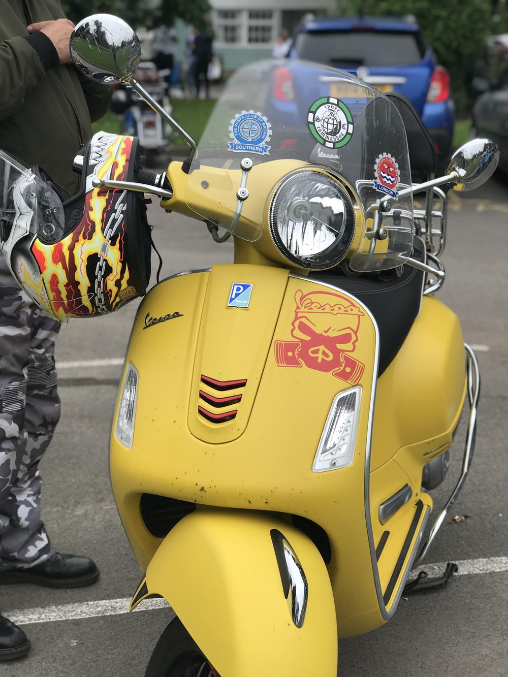 Yellow Vespa GTS scooter