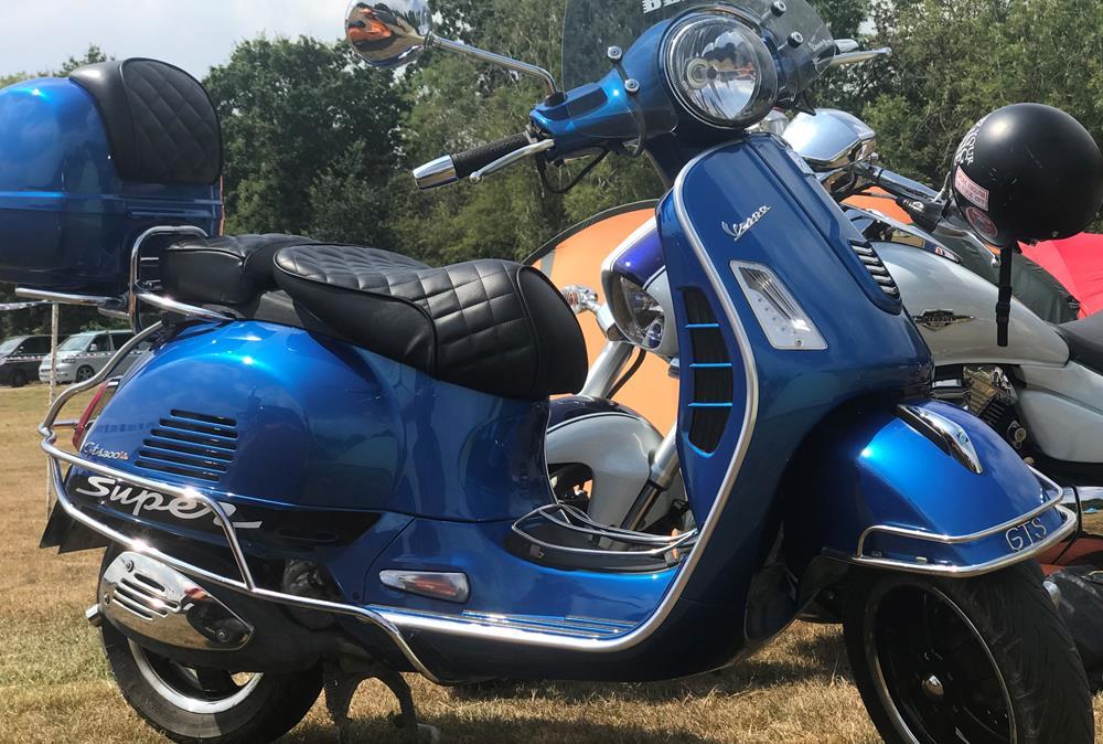 Blue Vespa GTS scooter