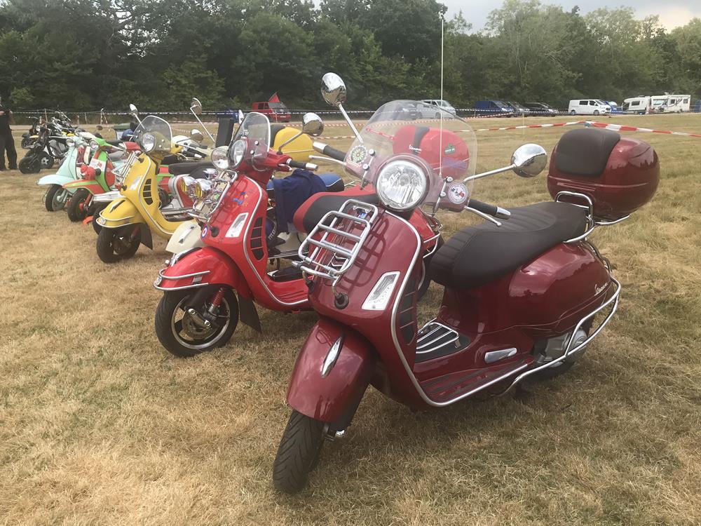 Burgundy Vespa GTS scooter