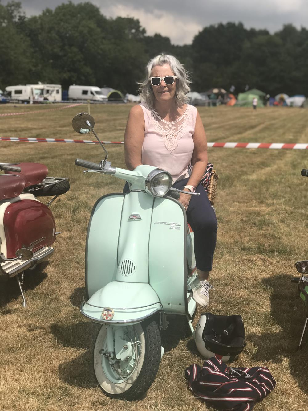 Lady sitting on a Lambretta LI 200 scooter at the Solent Cougars scooter rally 2018