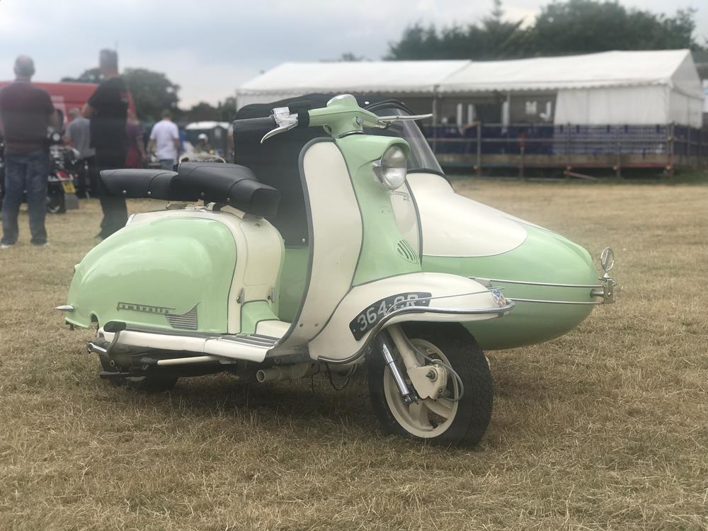 Green and cream Lambretta Series 1 scooter with sidecar