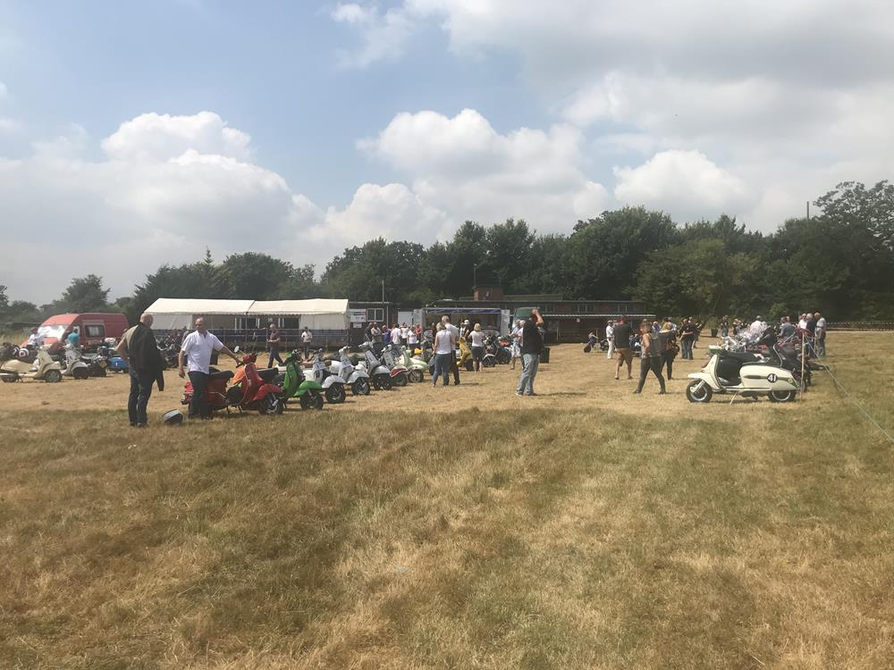 View of scooters and marquee on a field at the Solent Cougars scooter rally 2018