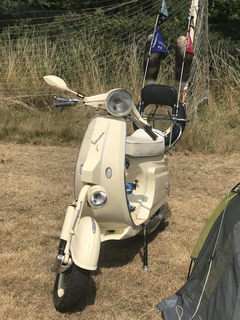 Cream Vespa chopper scooter