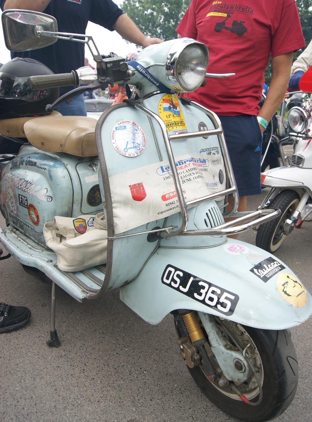 Lambretta scooter covered in stickers including Modrapheniacs Scooter Club ones on the side panels