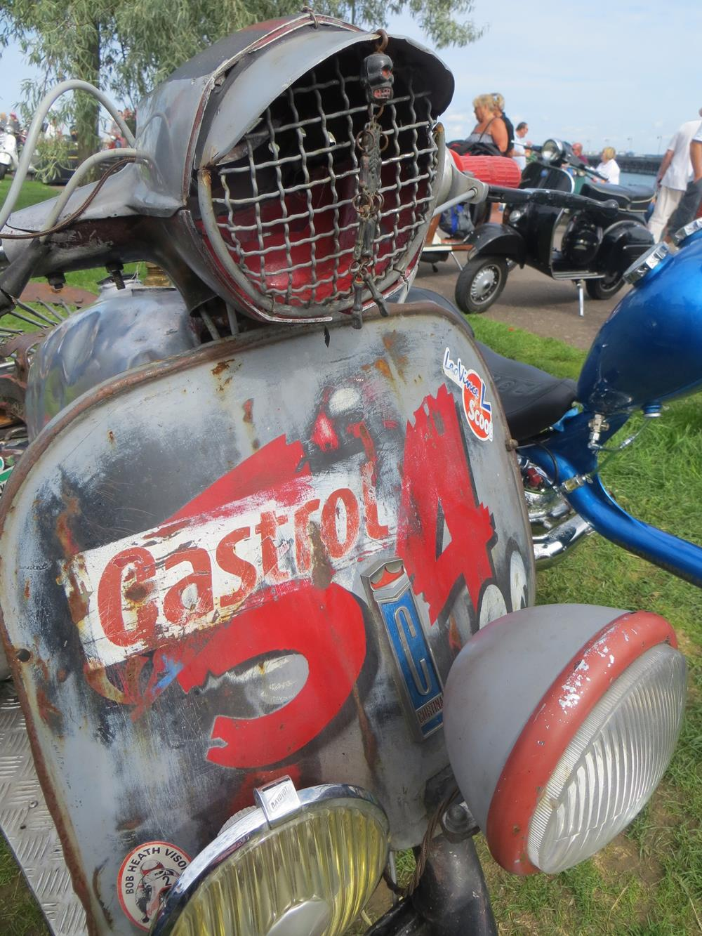 Vespa front legshields and headlight on rat rod scooter