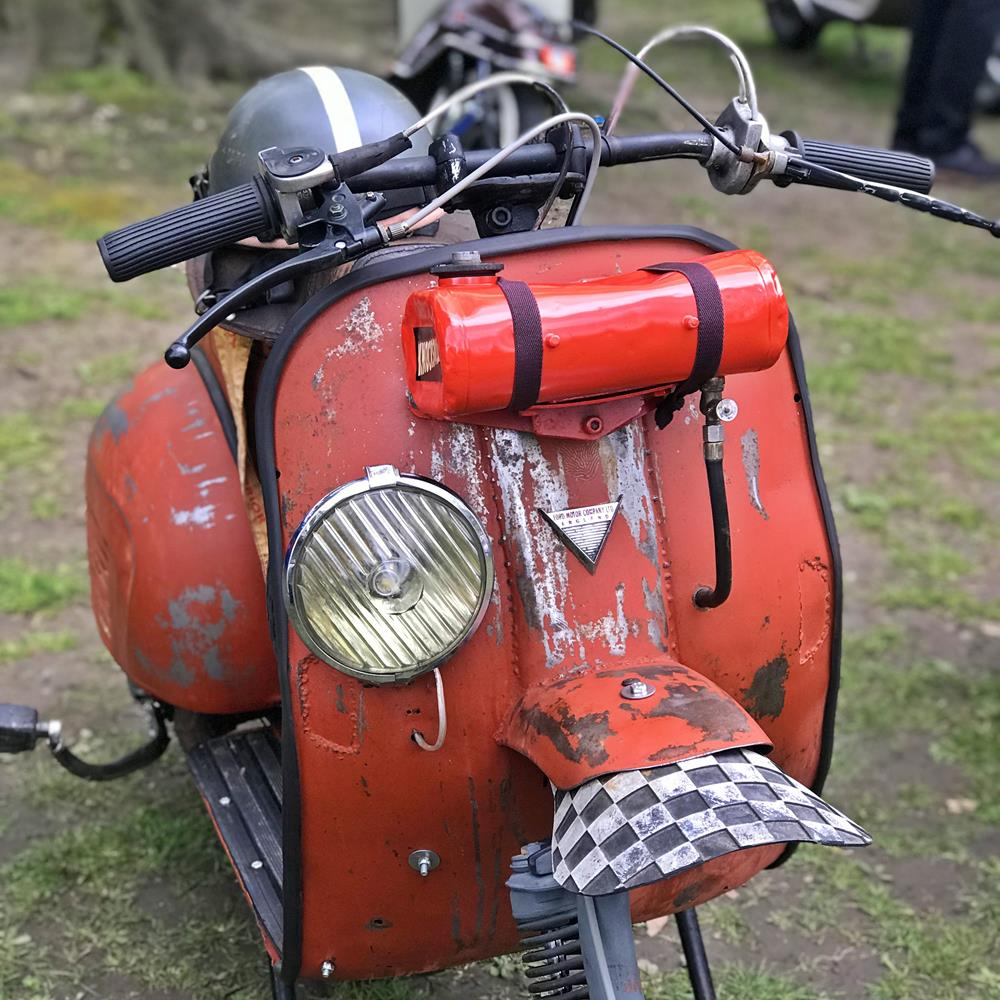 Vespa scooter with fuel tank on front legshields