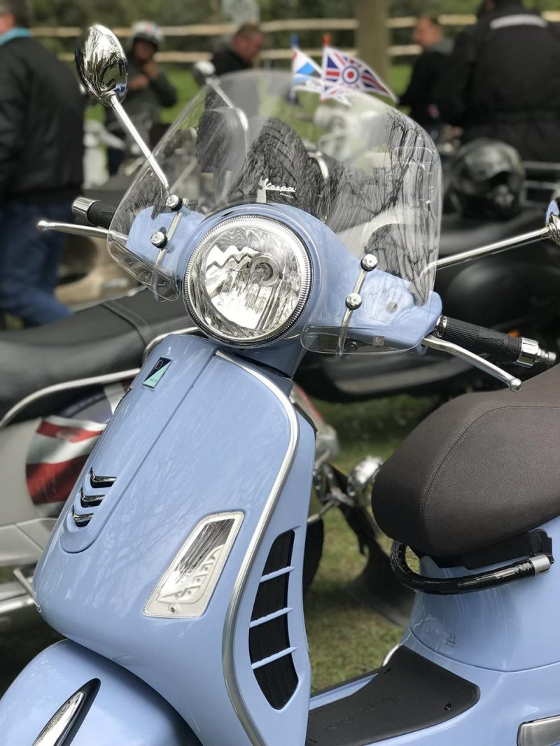 Blue Vespa GTS scooter