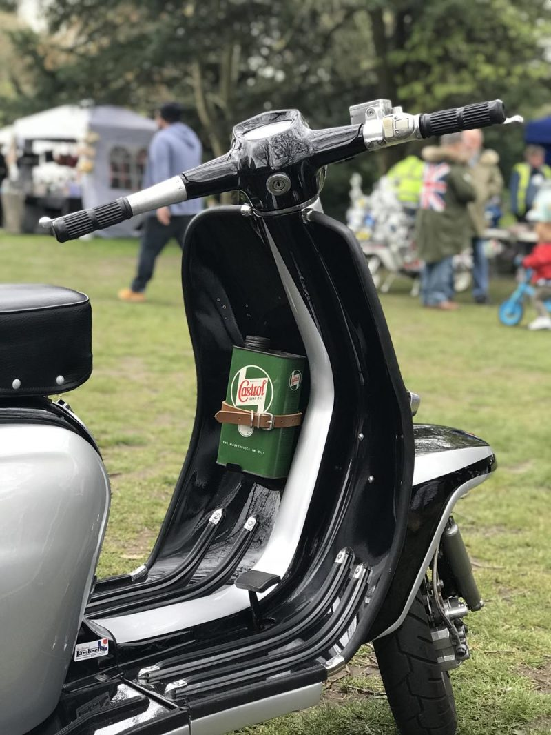 Black and silver TV175 Lambretta with bottle of Castrol oil in the front fairings