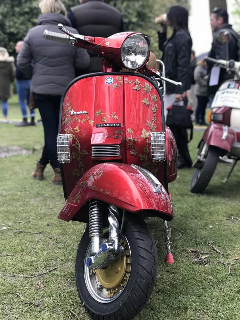 Richard Stewart's Vespa PX with gold flowers painted on the front fairing
