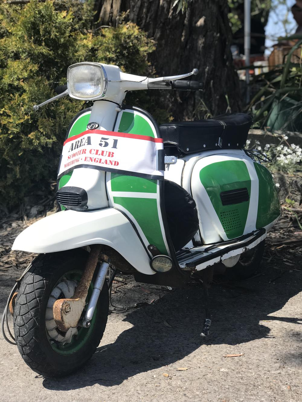 Green and white Lambretta scooter from Area 51 Scooter Club