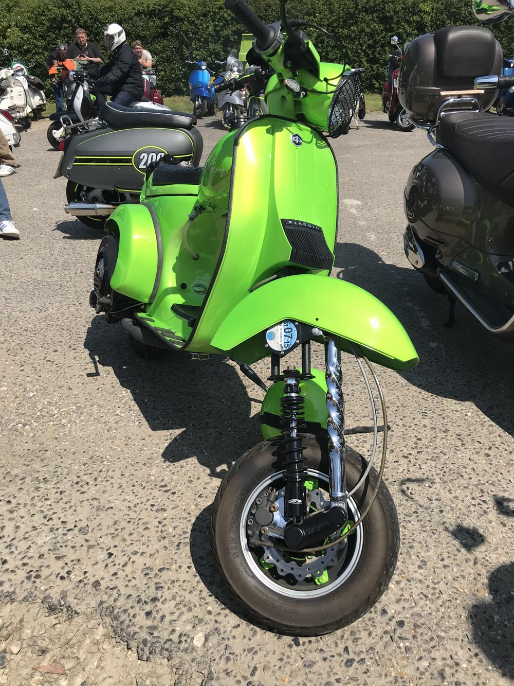 Bright green Vespa chopper scooter